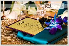 peacock wedding  Gold table cloths and peacock napkin with menu!