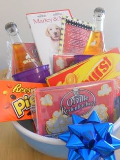 A Movie Night Basket  * A basket, or popcorn bowl      * Sodas      * Cups      * Microwave Popcorn      * Movie style candy      * Movie
