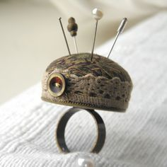 Keep your pins handy with this Mad Hatter style pincushion ring with a medieval feel to it. The ring base is a 30mm disc in antique bronze and