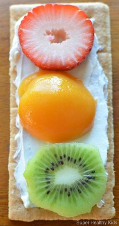 1 Graham Cracker  Cream cheese to spread  Strawberries, sliced  Apricots, halved  Kiwi, sliced.