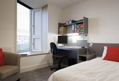 Student Village, Hawkins\Brown. student halls, rooms with shutters and angled windows
