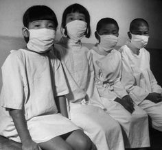 Hiroshima's children patiently wait their turn for a complete and detailed physical examination in ABCC's [Atom Bomb Casualty Commission] temporary laboratory clinic by Carl Mydans