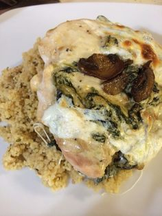 Chicken with creamed spinach, garlicky sautéed mushrooms and fresh melted mozzarella.  Yum