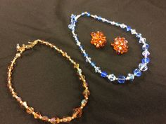 LOVELY LOT OF VINTAGE CRYSTALS INCLUDES A 16 INCH BLUE AURORA BOREALIS CRYSTAL NECKLACE, A 15 INCH AURORA BOREALIS ROOTBEER CRYSTAL NECKLACE AND A PAIR OF TOPAZ CRYSTAL CLIP ON EARRINGS. ALL IN LOVELY VINTAGE CONDITION.