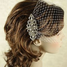 YETTA, Victorian Pearl and Rhinestone Bridal Hair Comb, Wedding Bridal Comb, Vintage Inspired Wedding Hair Accessories, Crystal Hair Comb. $68.00, via Etsy.