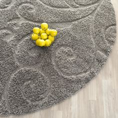 Create an ambience of serenity and tranquil with the beautiful Rowes Swirl Grey Area Rug. Made from 100% polypropylene, this beautiful rug remains true to its colors and look for a long period of time. This machine-woven area rug does not get damaged easily. Featuring simple yet elegant swirls, this rug instantly enhances the appearance of your room. Sporting an elegant gray color, this area rug effortlessly blends with any modern or contemporary home interior. This lovely Beige Shag Area…