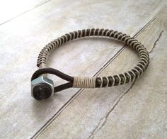 This rustic bracelet is a great choice from my Guys collection. Made from two strips of 3mm chocolate brown leather, rustic chain, and wrapped with a ivory linen rope. Leather loop closure and stainless steel nut. This bracelet makes the perfect present for any guy on your list.   Each bracelet is custom made to fit your wrist, so I will need your true wrist size. I will add extra length for that perfect fit. The easiest way to measure your wrist is to take a string, wrap it around your…