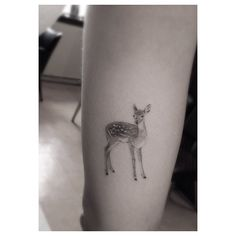 Little black-and-white fawn tattoo