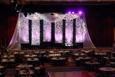 The backdrop at the end of the ballroom, from Hargrove, featured gobo projections of rosette shapes on sheer hanging fabric.