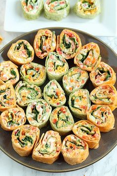 Colorful and delicious, Veggie Tortilla Pinwheels Appetizer is easy to make for tailgating. These small bites are the perfect healthy appetizer! appetizers for potluck Veggie Pinwheels Party Appetizer with Ranch Cream Cheese Spread Tortilla Pinwheel Appetizers, Tortilla Pinwheels, Pinwheel Recipes, Roll Ups Tortilla, Tortilla Rolls, Pinwheel Wraps, Turkey Pinwheels, Cream Cheese Pinwheels, Health Foods
