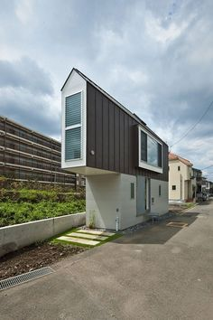 This extraordinary project was designed by Mizuishi Architects Atelier in Japan. The miniature 594-square-foot house is built on a tiny triangular site alongside a river. The way the space is utilised inside this cosy modern cottage is really quite impressive.  More info: Mizuishi Architect Atelie