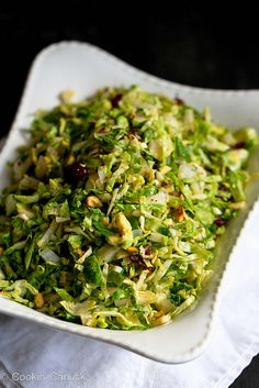 An easy & light Thanksgiving side dish. Shredded Brussels Sprouts with Pistachios, Cranberries & Parmesan | cookincanuck.com #Thanksgiving