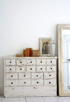 Love all the drawers in this unit. White Storage, White Oversized Mirror