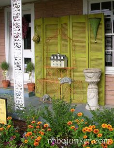 DIY Craft Projects using Old Shutters - Trash to Treasure.  love the painted green bifold doors on the porch