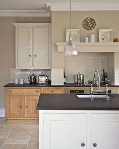This project includes: oak & hand painted kitchen, architectural and interior detailing, wall tiling, timber and stone flooring, farrow & ball colour scheme.