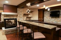 Contemporary Wet Bar with three sided fireplace feature
