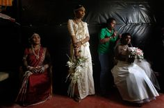 The Sri Lankan bride blends Eastern and Western traditions, donning heavily embroidered silk saris and European-looking veils. Her jewelry includes an uneven number of gemstones, as odd numbers are considered auspicious.