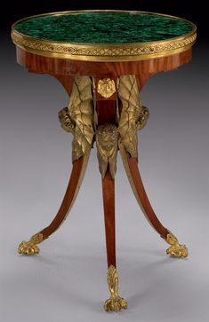 AN IMPERIAL NEOCLASSICAL ORMOLU-MOUNTED MAHOGANY GUERIDON ATTRIBUTED TO HEINRICH GAMBS AFTER A MODEL BY ANDREJ VORONIKHIN, RUSSIAN, CIRCA 1803