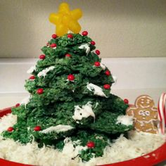 Christmas tree!! Rice Krispy treats, green food coloring and various sizes of star cookie cutters!! Decorate and enjoy!  :D