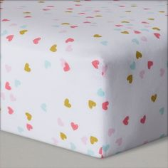 Your bundle of joy makes your heart feel full to bursting, and with the Hearts Fitted Crib Sheet from Cloud Island™, you can let them feel that love even when they're in dreamland. Lay baby down for nap time or bedtime on an array of dainty pink, blue and gold hearts decorating a white background that's sure to fill them with sweet dreams of how much mommy loves them. Made of 100% cotton and OEKO-TEX certified, this sheet is soft against new baby skin and free from harmful su...