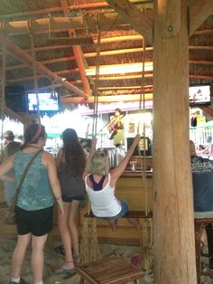 Inside Mojito Bay at Put-In-Bay in Ohio.  Yes that is a swing at the bar.