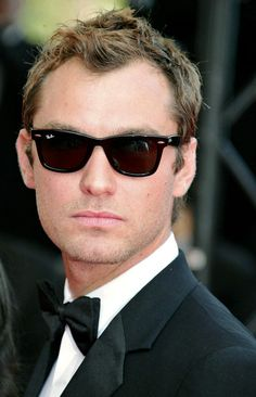 Jude Law with his infamous Hollywood glare while wearing wayfarer sunglasses