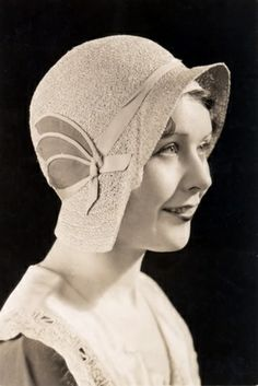 This was a 1930s Cloache hat by Coco Chanel. This is economic because this is a good in the 1930s and they showed you had money.