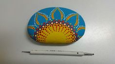 Painted rock by Donna Reichenberger. I use acrylic paint.