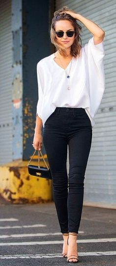 Women's Black Sunglasses, Blue Pendant, White Long Sleeve Blouse, Black Skinny Jeans, Black Leather Crossbody Bag, and Tan Leather Heeled Sandals