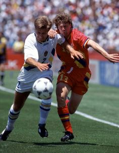 Sweden 2 Romania 2 in 1994 in San Francisco. Roland Nilsson and Tibor Selymes battle for the ball in the World Cup Quarter Final.