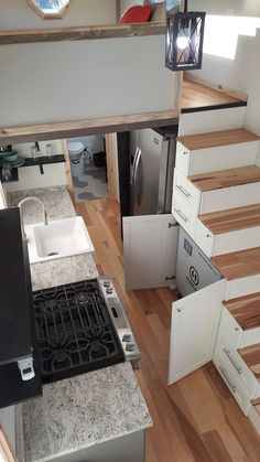 The storage stairs provide space for the Humless battery bank, plus there are several drawers and cubbies.