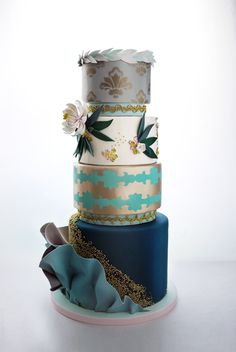 It's your wedding day, so however you vision your wedding cake to look, it can be done.  // Charm City Cakes