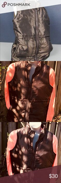 "NWT:  New directions bronze metallic large vest New directions bronze metallic puffer vest, zip front, 100% polyester approximate measurements: L 26"" chest: 42"" new directions Jackets & Coats Vests"