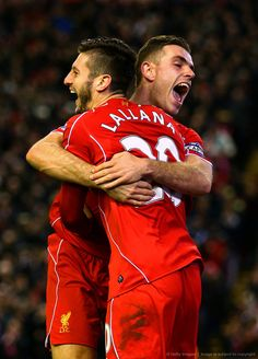 Jordan henderson and Adam Lallana celebrating