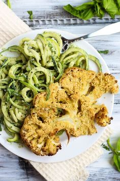 These Vegan Parmesan Cauliflower Steaks over Hemp Pesto Zoodles feel gourmet but are done in 1 hour! This gluten-free dinner is perfect to impress anyone.