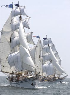 "The twin brigantines, ""Irving Johnson"" and ""Exy Johnson"", under full sail with Harbor area youth. As far we know, these identical tall ships are the only twin brigantines in the world!"