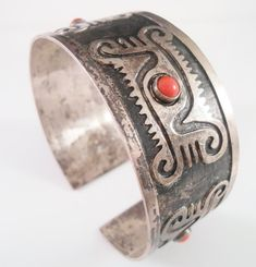 Ecuadorian Tribal Coral 900 Silver Cuff Bracelet. Measures 2 1/2 across the inside and 1 1/8 wide. Tribal symbols with coral accents. Marked on