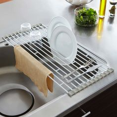 This dish rack will not slip off of the counter and will provide a secure spot for your dishes to dry. The slats in the drying rack can be moved and removed to accommodate your dishes and it folds to a smaller size if needed.