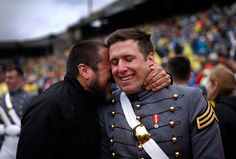 Graduating cadet Caleb Guzik from Virginia Beach, Va., is embraced by his father Steve Guzic after Caleb graduated with the class of 2013 from the United States Military Academy at West Point. Mike Segar / Reuters
