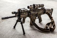 SCAR-H. Some kind of scale pattern camouflage. Bipod, scope sight, laser, sling. jdm