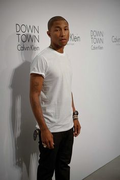 WHITE TEE & BLACK JEANS, not to mention it's Pharrell