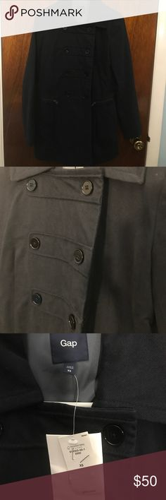 """Dark Navy Spring/Fall Pea Coat Brand new with tags Gap XS spring/fall pea coat. Military style buttons (8) on the front of the jacket. Dark navy color, almost looks black! Two functioning zipper pockets. Size XS- would fit a size 2 well. My sister is a 4 and can fit, but the arms are tight if she crosses them across her body. She is 5'8"""" and the jacket hits high thigh/covers her butt. Let me know if you have questions or need measurements! SMOKE FREE home! GAP Jackets & Coats Pea Coats"""