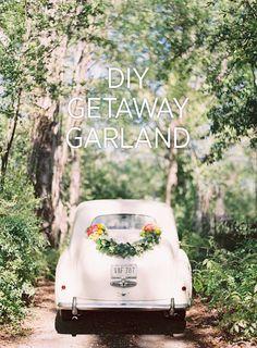 DIY Wedding Getaway Garland by Rosegolden Flowers via Once Wed, photo Odalys Mendez, styling Ginny Au.