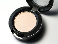 "MAC Vanilla. Nice for an all over lid color. Brightens, but doesn't scream ""I'M WEARING EYESHADOW GUYS!"""