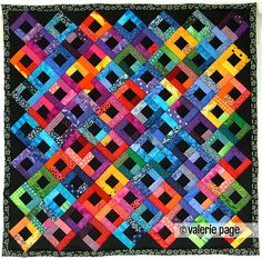 Bright Scraps on Black Quilt - PageQuilts.com - Feel the Warmth Under A Quilt