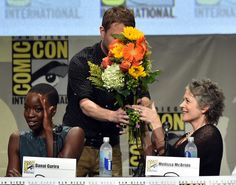 """(L-R) Actress Danai Gurira, moderator Chris Hardwick and actress Melissa McBride attend AMC's """"The Walking Dead"""" panel during Comic-Con International 2014 at San Diego Convention Center on July 25, 2014 in San Diego, California."""