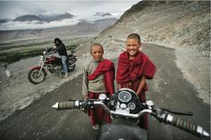 Buddhist monks, as seen from a Royal Enfield, in Ladakh, India