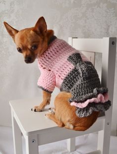 The Oxford Crochet sweater for your little lap dog! Smart sophisticated doggies only, please! : ) Attached Bowtie is to die for but does NOT come off. Has 3 rows of ruffles for your pampered pooch. The Oxford Dog Sweater is available in 3 sizes so BE SURE TO MEASURE YOUR PUP BEFORE YOU ORDER. This will NOT fit larger dogs!! If you have questions about the fit or sizing or need a customization please convo me prior to purchasing for availability. Small: Maximum of 9 around neck, 15 aroun...