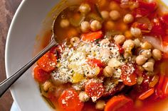 This satisfying, colorful soup is loaded with chickpeas and vegetables, and it's incredibly easy to make There's not much more to it than tossing everything into a pot and letting it simmer for a couple of hours (no sautéing!) until everything is tender Do not forget to finish the soup with a flurry of the rosemary, Parmesan, lemon zest and pepper mixture