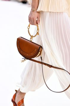 Highlights from the runways. Chloé In the spring, lighter and simpler is best — and that goes for your handbag, too. This scaled-down bag does double duty with a large gold ring that is both handle and bracelet. Fall 2016